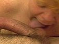 This mature redhead gives a long hot blowjob. Sucking and licking cock and working his balls hard until he shoots his hot load of cum.