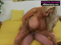 Mature golden-haired milf with huge tits sucks and fucks