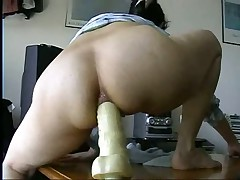 Watch this masked British play around on video with her boyfriend.  First she spreads her goods to show what she has to offer before she straddles a huge dildo up her ass.  Listen to her wince as she tries to get it up as far as she can take it up the pooper.  She's a real trooper as she does what her boyfriend tells her to do with the dildo.  Great way to train her for anal.