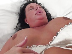 Cindy may not have a gorgeous face but she surely compensates with her huge boobs. This chubby slut wishes a dick in her cunt and mouth as she puts the dildo between her jugs and sucks it then uses it to masturbate.