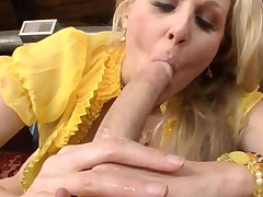 Busty mature hottie is engulfing on dude's pecker hungrily