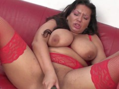 Large breasted older slut playing with her food