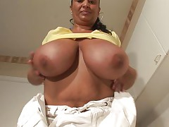 This chubby brunette summary dressed is in the kitchen on the floor. She shows her huge tits perfect for a fuck and after that she begins to play with her boobs and her large pussy. Her husband is a lucky bastard to have a housewife with this enormous tits that surely he fucks every day.
